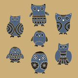 Set of cartoon owls and owlets on a beige background Stock Photo