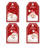 Set of cartoon red Christmas tag or label with laughing and smiling Santa Claus in hat. Xmas gift tag, invitation banner Stock Images