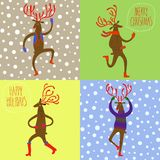 Set of cartoon reindeers. Christmas illustration with set of four cute dancing deers on snowflake background Stock Photography