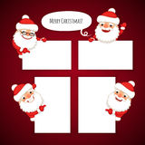 Set of Cartoon Santa Clauses Behind a White Empty Stock Photography