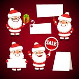 Set of Cartoon Santa Clauses Holding a White Empty Banners Royalty Free Stock Photography