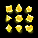 Set of cartoon yellow different shapes crystals. Gemstones,gems,diamonds vector gui assets collection for game design.isolated vector elements.Gui elements Royalty Free Stock Photo