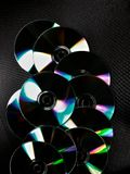 Set of cds. Bright cds  against black background with colorful  reflections Stock Photography
