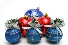 Set of celebratory christmas-tree decorations of blue color. Set of celebratory christmas-tree decorations of dark blue and red color on a white background Stock Photos