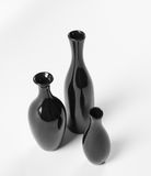 Set of ceramic black vases on white background. Royalty Free Stock Photography