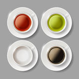 Set of ceramic cups with beverages of coffee, green and brown te Royalty Free Stock Image