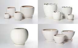 Set of ceramic flowerpots. On light background Royalty Free Stock Photography