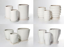 Set of ceramic flowerpots. On light background Stock Photos