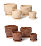 Set of ceramic flowerpots for indoor plants. On white background Royalty Free Stock Photos