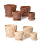 Set of ceramic flowerpots for indoor plants. On white background Royalty Free Stock Images