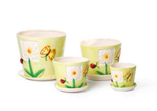 Set of ceramic flowerpots for indoor plants. On white background Stock Image