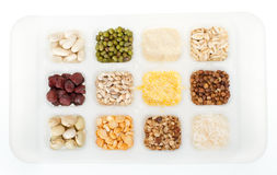 Set of cereals and grains on white tray Royalty Free Stock Images