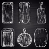 Set of chalk drawn cutting boards. Kitchen theme. Stock Photos
