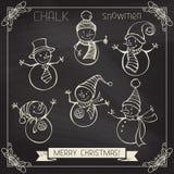 Set of chalk snowmen. Royalty Free Stock Photography