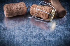 Set of champagne corks twisted wire corkscrew on metallic backgr Stock Images