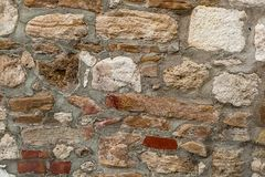 Set chaotic weathered beige gray stones limestone brick cemented cement sturdy base close-up royalty free stock photography