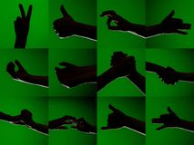 A set of characters on the fingers of human hands that are depicted by silhouettes on an isolated green background royalty free stock photo