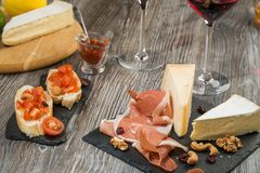 Set of cheese, jamon, bruschettas, nuts Stock Photo