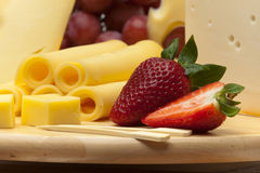A set of cheese on a wooden board Royalty Free Stock Images