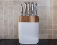 Set of chef knives on kitchen counter Royalty Free Stock Image