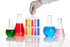 Set of chemical flasks and test tubes. With a hand holds one of them royalty free stock photos