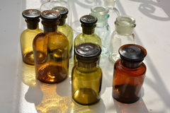 A set of chemical flasks of various forms and colors Royalty Free Stock Photos