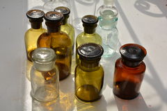 A set of chemical flasks of various forms and colors Royalty Free Stock Images