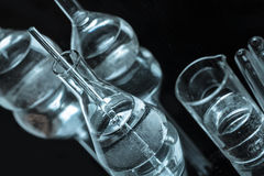 Set of chemical glass vials with reflection Stock Photo