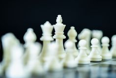 Close up chess pieces on chessboard Royalty Free Stock Photo