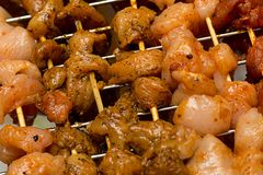Set of chicken pork chicken pieces flavored pickled on a wooden skew covered curry close-up royalty free stock images