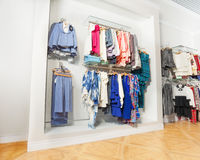 The set of children clothes hanging on hangers Stock Images
