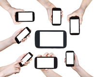 Set of children hands with smart phones isolated Royalty Free Stock Photography