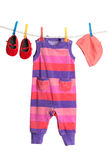 A set of children's clothes hanging Royalty Free Stock Images
