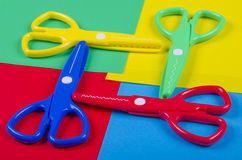 Set for children's creativity with colored paper and plastic scissors Royalty Free Stock Images