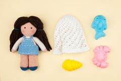 Set - children`s panama, toys for sand, amigurumi dolls with brown hair. The concept of vacations, games in kindergarten. Royalty Free Stock Photos