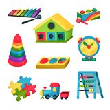 Set of children s toys. Xylophone, pyramid with rings, abacus, puzzles, clock, train, house with holes for geometric. Set of colorful children s toys. Xylophone Stock Photography