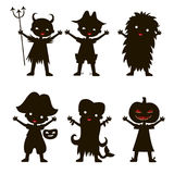Set of children silhouette in Halloween costume. And dress on the white background. Vector kids carnaval suits Stock Photography