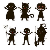 Set of children silhouette in Halloween costume. And dress on the white background. Vector kids carnaval suits Stock Photo