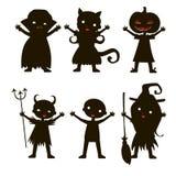 Set of children silhouette in Halloween costume Stock Photo