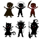 Set of children silhouette in Halloween costume Stock Photography