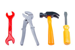 Set children& x27; s zabawki narzędzia plastikowy kolor odizolowywający na białym backg Obrazy Royalty Free