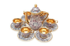 Set of chinaware. Kettle and six cups isolated on white royalty free stock photography