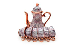 Set of chinaware with kettle. And six cups isolated on white Royalty Free Stock Photo