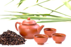 A set of Chinese tea in clay. Chinese tea in clay cup close up with tea set and chinese tea background Stock Photos