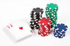Set of chips and cards. Cards anc chips over a white table stock image