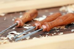 Set of chisels on wooden table. In workshop Royalty Free Stock Photo