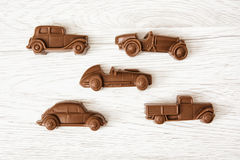 Set of chocolate car figures on wooden background Stock Photography
