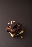 Set of Chocolate with nuts on dark background Stock Photography