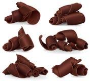 Set of chocolate shavings on white background Stock Photos