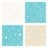 Set of Christmas backgrounds with hand drawn snowflakes, stars and frozen texture. Vector winter patterns. Stock Photography